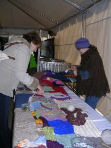 This fairgoer has donated a few rows and will sit and knit for a little while...in the heated tent!