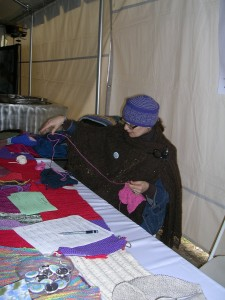 This volunteer is knitting rows that have been donated by sponsors...she was busy all day!
