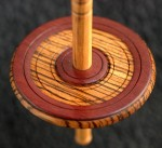 color photo: closeup of Hatchtown llaminated whorl - Padauk and Zebrawood