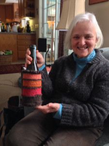 Me and my wine cozy. Wine because we enjoyed a couple of glasses on our retreat and I used the magic loop method that Chris taught us while we were there. I spun the fiber for the salmon color at the top. The dark brown is from our sheep.